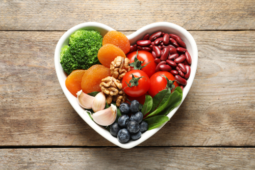 Healthy food in a heart-shaped bowl