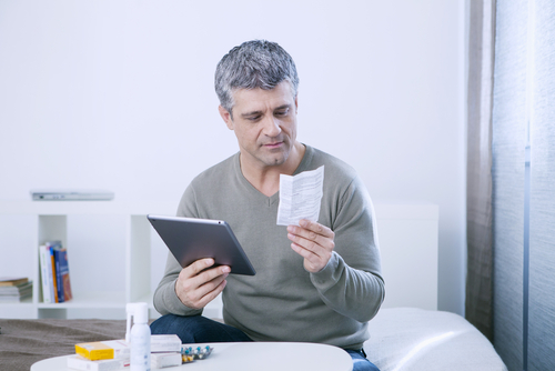 A man reading his prescription