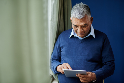 A senior using a tablet